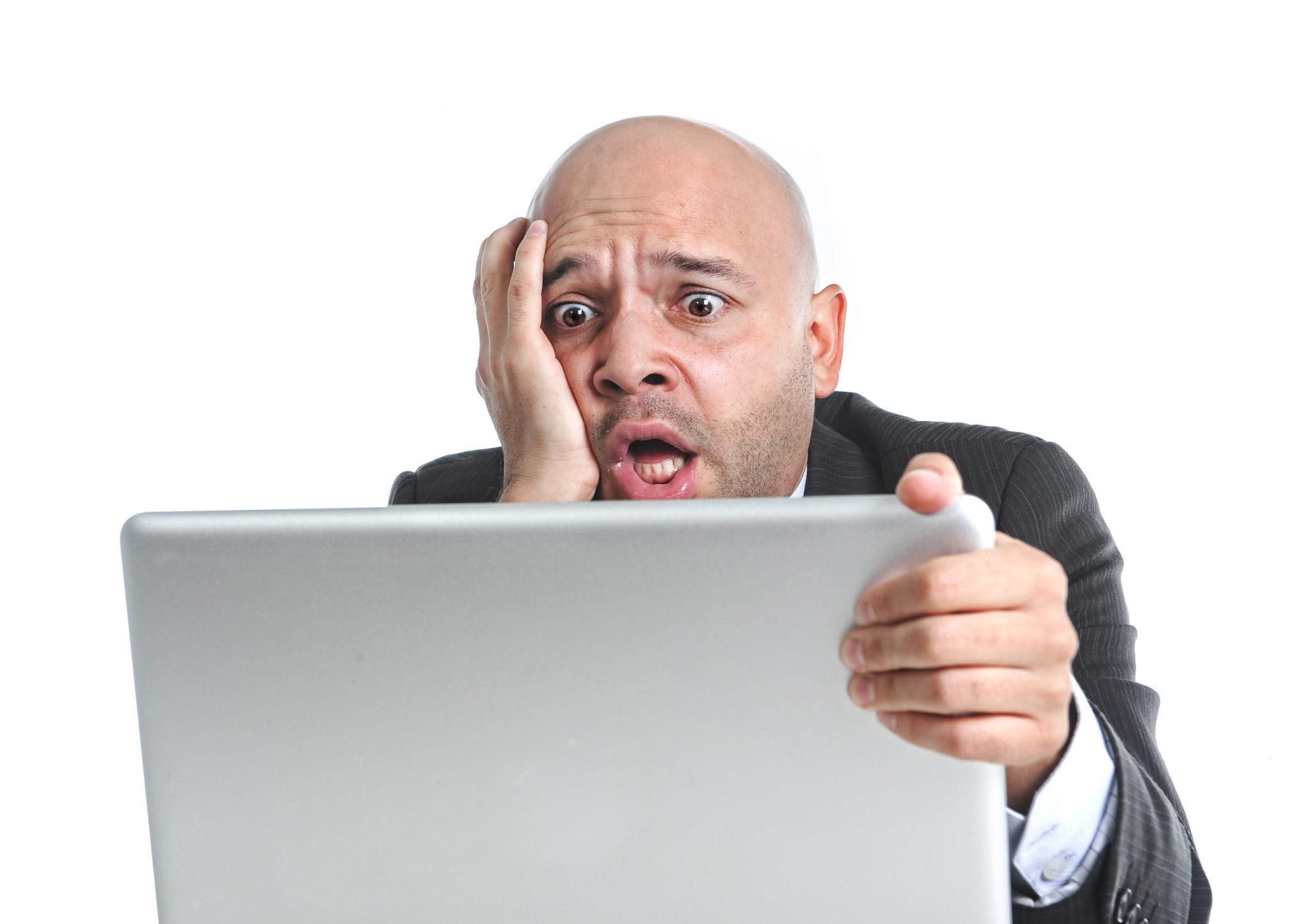 businessman in crisis and stress at computer laptop holding monitor watching online his funding fall through
